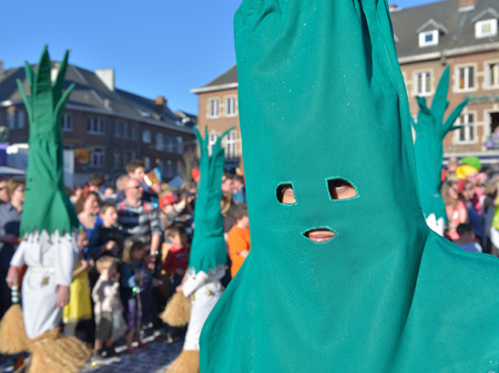 walloon: NIVELLES, BELGIUM-MARCH 03, 2014: Unidentified participant of parade demonstrates his costume in defile during yearly carnival in Nivelles