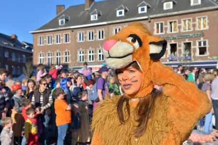 defile: NIVELLES, BELGIUM-MARCH 03, 2014: Unidentified happy participant of parade demonstrates her costume in defile during yearly carnival in Nivelles