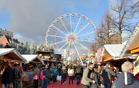 BRUSSELS, BELGIUM-DECEMBER 6, 2014: Christmas market on square Vismet is very popular attraction for tourists and local people