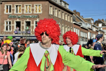 defile: NIVELLES, BELGIUM-MARCH 03, 2014: Group in fancy dresses participates in defile during yearly carnival in Nivelles Editorial
