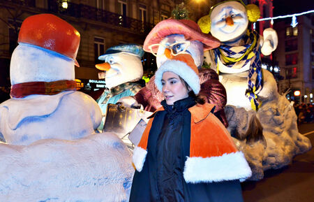 defile: BRUSSELS, BELGIUM-DECEMBER 14, 2014: Christmas Parade defile in frame of Winter Wonders events moves by boulevard Anspach