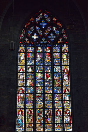 wallonie: WALCOURT, BELGIUM-SEPTEMBER 28, 2014: Cathedral window in basilica Saint-Materne. The basilica was built in 11 century and it is a home of statue of Black Madonna of Walcourt