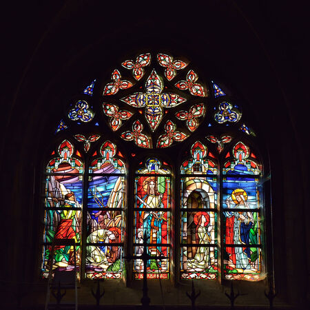 vitrage: WALCOURT, BELGIUM-SEPTEMBER 28, 2014: Cathedral window in basilica Saint-Materne with image of Saint Barbara. The basilica was built in 11 century and it is a home of statue of Black Madonna of Walcourt