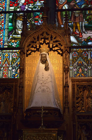walloon: WALCOURT, BELGIUM-SEPTEMBER 28, 2014: Statue of Black Madonna in basilica Saint-Materne. The basilica was built in 11 century and it is a home of 10 century statue of Black Madonna of Walcourt Editorial