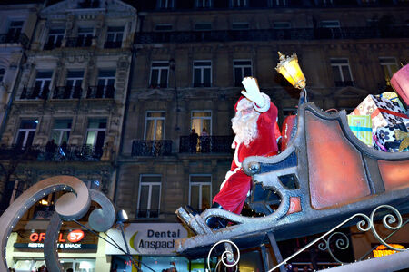 BRUSSELS, BELGIUM-DECEMBER 14, 2014: Saint Nicholas greets public during Christmas Parade defile in frame of Winter Wonders events moves by boulevard Anspach Editorial