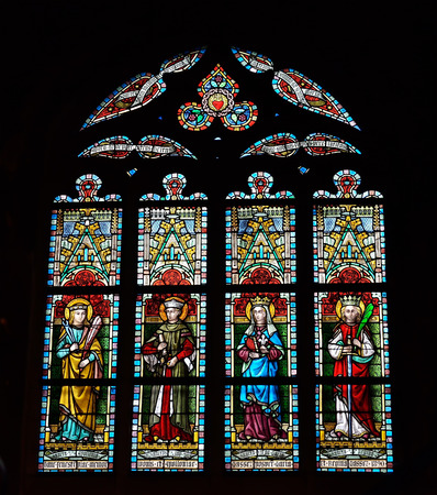 church window: LESSINES, BELGIUM-JANUARY 11, 2015: Stained glass window in Saint Hermes church. Current building is known from 15 century