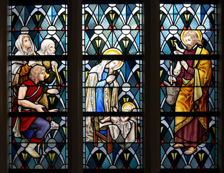 leuven: LEUVEN, BELGIUM-SEPTEMBER 12, 2014: Stained glass window in Saint Antonys Chapel. The chapel was built circa 1329. Editorial