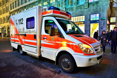 public service: LEIPZIG, GERMANY-DECEMBER 21, 2014: Vehicle of Feuerwehr Emergency service on duty during Christmas market. This public service with phone number 112 is available in many European countries