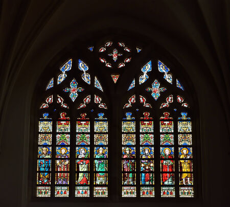 walloon: LESSINES, BELGIUM-JANUARY 11, 2015: Stained glass window in Saint Hermes church with images of saints Editorial
