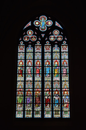LESSINES, BELGIUM-JANUARY 11, 2015: Stained glass window in Saint Hermes church. Current building is known from 15 century