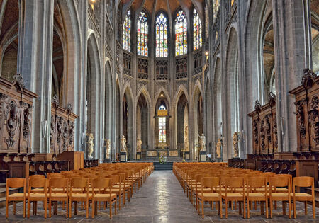 MONS, BELGIUM-OCTOBER 10, 2014: Interior of Collegiate church Saint Waudru. Construction of this church started in 1450 and never ended