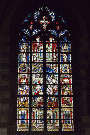 wallonie: MONS, BELGIUM-OCTOBER 10, 2014: Cathedral window in Collegiate church Saint Waudru. Construction of this church started in 1450 and never ended
