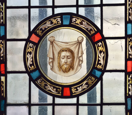 wallonie: MONS, BELGIUM-OCTOBER 10, 2014: Cathedral window in Collegiate church Saint Waudru. Image of Jesus in chapel of Our Lady of Grace