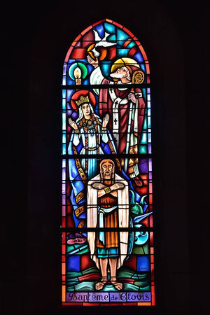 baptizing: ATHIS, FRANCE-JULY 14, 2014: Baptizing of Clovis I, the first king of franks, image on stained glass window in church of Athis Editorial