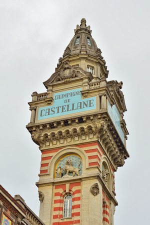 producer: EPERNAY, FRANCE-JULY 14, 2014: Historical tower of Champagne de Castellane producer of champagne wines