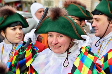 defile: NIVELLES, BELGIUM-FEBRUARY 22, 2015: Unidentified participant greets visitors during annual carnival defile on central square. Editorial