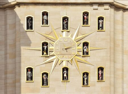 decoraton: BRUSSELS, BELGIUM-MARCH 06, 2015: Giant wall clock with statues above of the carillon on the wall of Palace of Dynasty