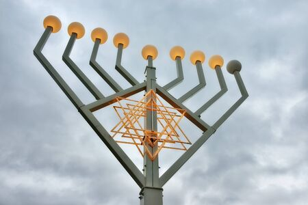 jewish community: BERLIN, GERMANY-DECEMBER 23, 2014: Menorah installed on the street of Berlin for greetings with Christmas from Jewish community Editorial