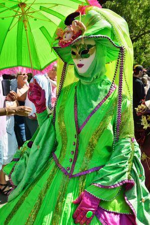 defile: MOUSCRON, BELGIUM-JUNE 06, 2015: Participants of defile in costumes of Carnival de Venice in Parc Communal during 6 edition of Venice in Mouscron Promenade