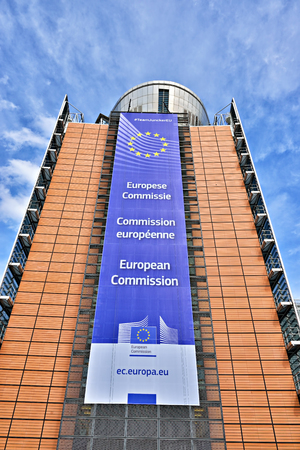 headquarter: BRUSSELS, BELGIUM-APRIL 27, 2015: The European Commission headquarter the Berlaymont building decorated with EU flag and the Commission title