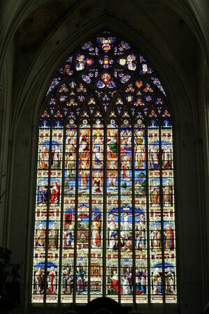 vitrage: MECHELEN, BELGIUM-JULY 31, 2014: Stained glass windows in St. Rumbolds Cathedral in Mechelen. This cathedral was consecrated in 1312 and has 97 meters tower Editorial