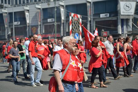 austerity: BRUSSELS, BELGIUM-JUNE 6, 2013: Belgian people participate in demonstration against austerity measures and requesting an equal status for employees and workers in Brussels. Editorial