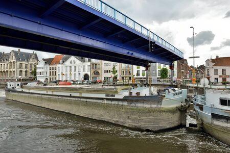 draw bridge: OUDENAARDE, BELGIUM-JUNY 23, 2015: Big barge cross the city Oudenaarde under draw bridge
