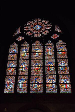 church window: OUDENAARDE, BELGIUM-JUNY 23, 2015: Stained glass window in church Saint Walburga, known from 11 century