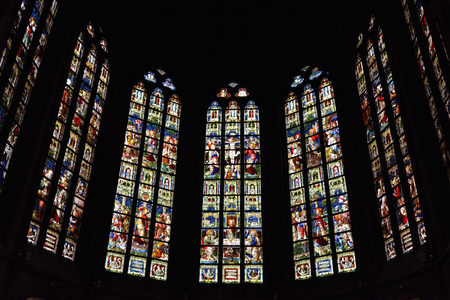 glass building: OUDENAARDE, BELGIUM-JUNY 23, 2015: Stained glass window in church Saint Walburga, known from 11 century