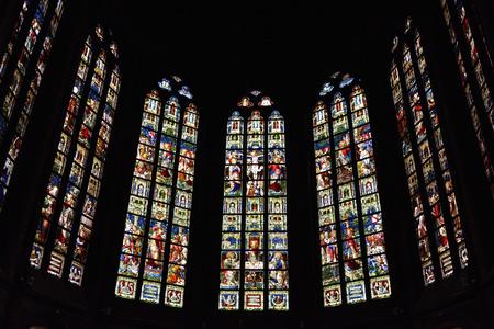OUDENAARDE, BELGIUM-JUNY 23, 2015: Stained glass window in church Saint Walburga, known from 11 century