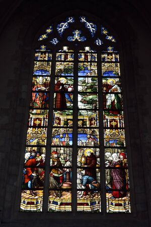 vitrage: OUDENAARDE, BELGIUM-JUNY 23, 2015: Stained glass window in church Saint Walburga, known from 11 century