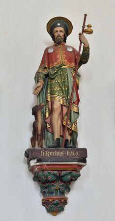 statue: OUDENAARDE, BELGIUM-JUNY 23, 2015: Statue of St. Rochus in church Saint Walburga, known from 11 century