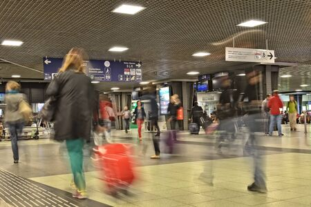 return trip: BRUSSELS, BELGIUM-SEPTEMBER 26, 2014: Interior with motion blur of Brussels-South Railway Station or Gare du Midi. This is the biggest railway station of the city which was opened in 1952