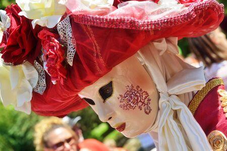 walloon: MOUSCRON, BELGIUM-JUNE 06, 2015: Participant of Venice in Mouscron promenade in Parc Communal demonstrates costume of venetian carnival Editorial