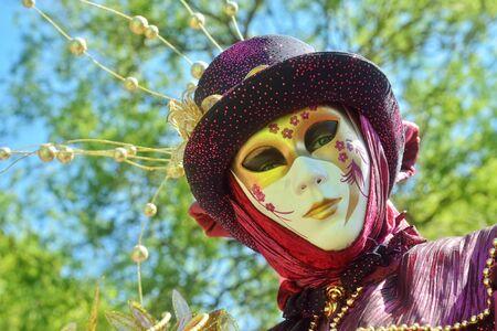 defile: MOUSCRON, BELGIUM-JUNE 06, 2015: Participant of Venice in Mouscron promenade in Parc Communal demonstrates costume of venetian carnival Editorial