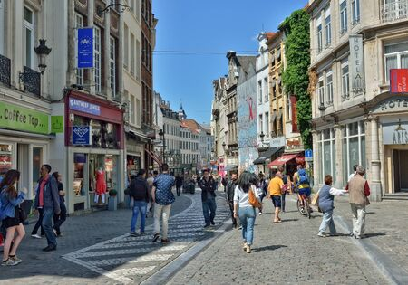 going places: BRUSSELS, BELGIUM-JUNE 6, 2015: Tourists walk in historical center of Brussels near Central railway station Editorial