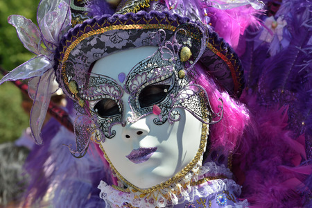 defile: MOUSCRON, BELGIUM-JUNE 06, 2015: Unidentified participant of 6 edition of Venice in Mouscron defile in Parc Communal of the city demonstrates colourful costume