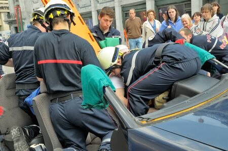 paramedical: BRUSSELS, BELGIUM-MAY 5, 2013: Members of Belgian rescue service demonstrate their skills during annual Day of Iris - Fete de in Brussels. Editorial