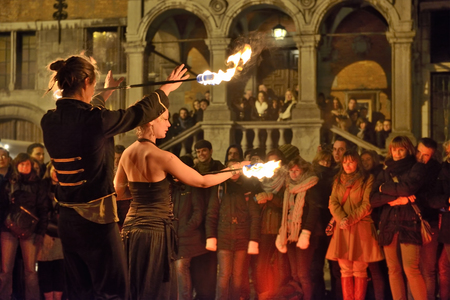 HALLE, BELGIUM-NOVEMBER 29, 2014: Artistic group shows dances with fire on Central Square in Halle, Belgium Editorial