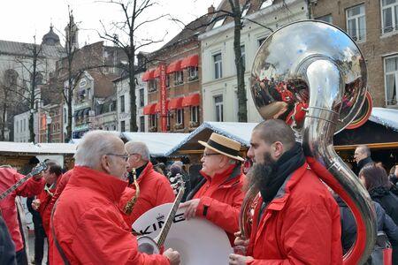 BRUSSELS, BELGIUM-DECEMBER 6, 2014: Christmas Market in historical center of Brussels in frame of Winter Wonders celebrations. Street concert
