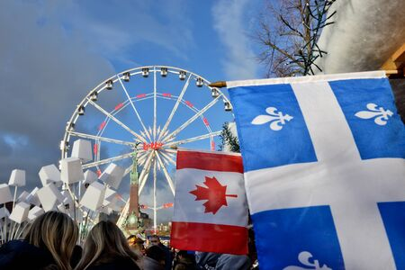 BRUSSELS, BELGIUM-DECEMBER 6, 2014: Christmas Market in historical center of Brussels in frame of Winter Wonders celebrations. Flags of Canadian participants