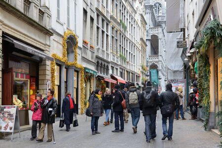 BRUSSELS, BELGIUM-DECEMBER 05, 2014: Crowded street Rue Au Beurre center in Brussels, very popular entre local people and tourists way to Grand Place Editorial