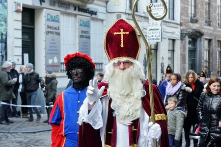 saint: BRUSSELS, BELGIUM-DECEMBER 6, 2014: Traditional Parade of Saint Nicolas moving to Grand Place of Brussels