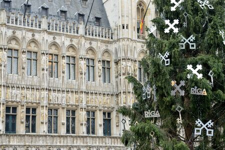 BRUSSELS, BELGIUM-DECEMBER 5, 2014: Grand Place of Brussels with installed Christmas Tree, decorated with symbols of Riga, capital of Latvia
