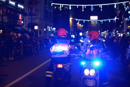 defile: BRUSSELS, BELGIUM-DECEMBER 14, 2014: Police protects RTL Christmas Parade defile on boulevard Anspach