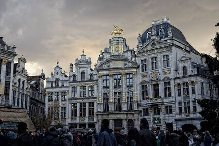 BRUSSELS, BELGIUM-DECEMBER 6, 2014: Crowded by tourists Grand Place of Brussels with installed Christmas Tree, decorated with symbols of Riga, capital of Latvia Editorial