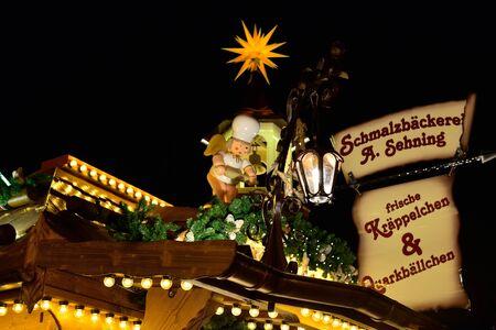 LEIPZIG, GERMANY-DECEMBER 21, 2014: Christmas market in historical center of Leipzig in evening