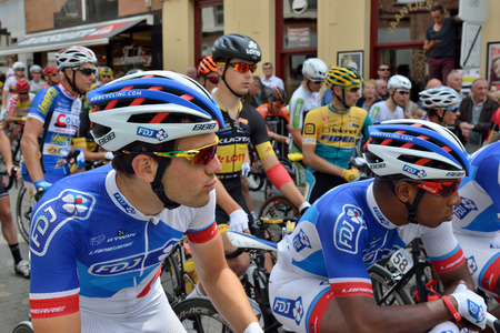 Halle, Belgium-June 24, 2015: Participants of cycling race cross historical center of city Editorial