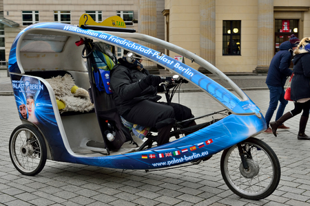 velo: BERLIN, GERMANY-DECEMBER 23, 2014: Velo rickshaw on the street in Berlin Editorial