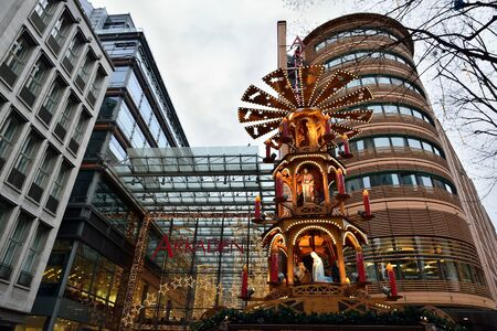 BERLIN, GERMANY-DECEMBER 24, 2014: Mall Arcaden decorated for Christmas with traditional tower and statues.